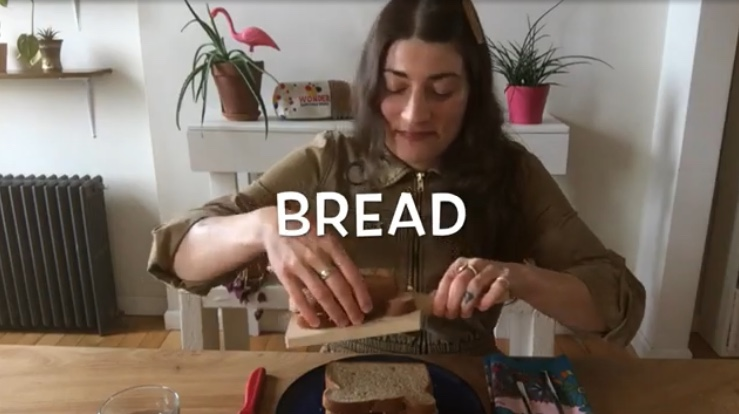 image of a librarian making a sandwich with the work bread superimposed